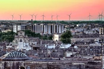 Skyline of the city of lecce with windmills in background