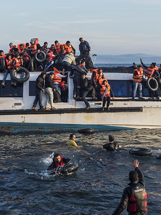 Syrian and Iraqi immigrants getting off a boat