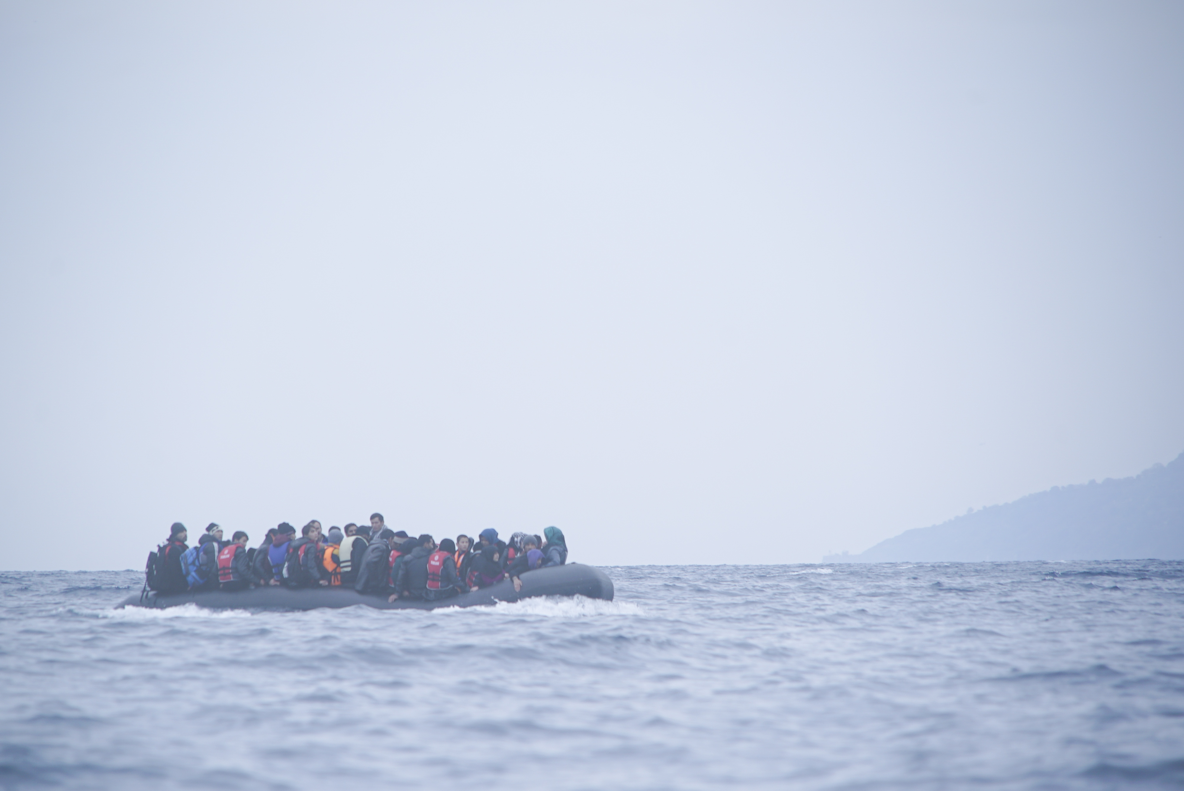Refugees in a boat on the sea