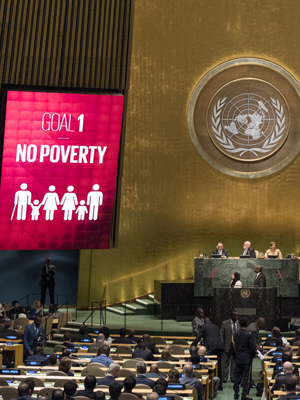 sustainable development goal number 1 on screen in UN conference